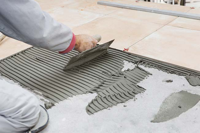 tile setter laying tile